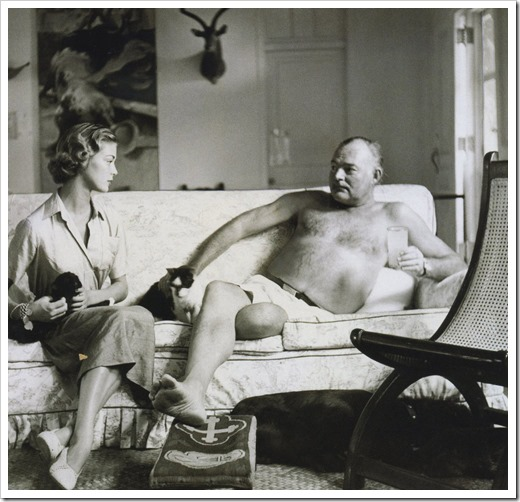 Jean Patchett with Ernest Hemingway at his ranch in Cuba (with dogs & cats), photo by Clifford Coffin